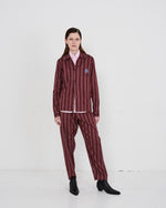 Load image into Gallery viewer, Model wears The Academy New York Crest PJ Shirt and PJ Pant in burgundy stripe.