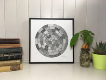 Load image into Gallery viewer, Seen in situ, circular monochrome image inspired by manhole cover designs