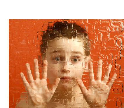 Image of boy with autism looking through distorted glass