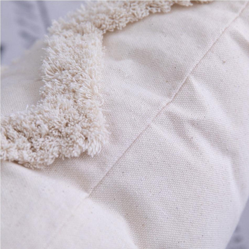 A close up on the heavy texture on this cushion. The main body of the cushion is smooth cotton and the texture is like long shag pile carpet.