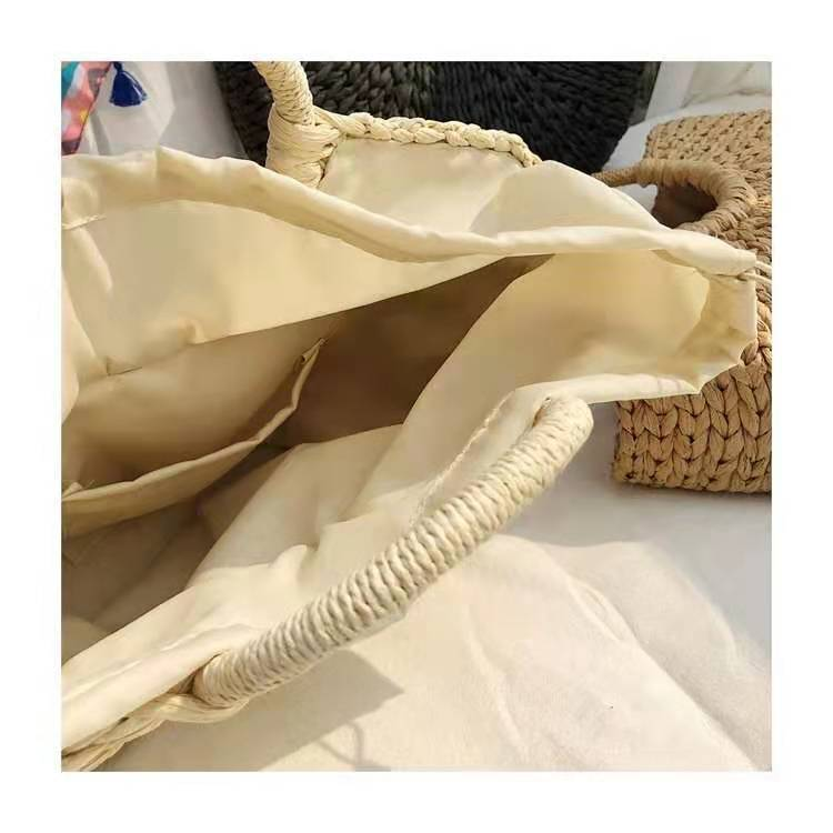 Image shows the inside of the half moon bay bag. It is lined in fabric with a small pocket. The fabric has a draw string top to cover contents inside your bag.