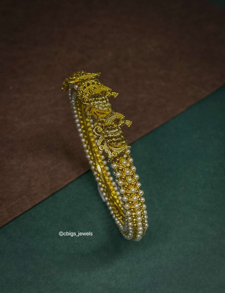 Beautiful Antique Finish Pearl Kada studded with Rice Pearls