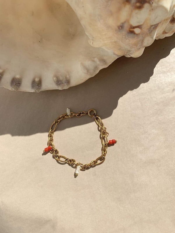 Statement bracelet with red and cream beads