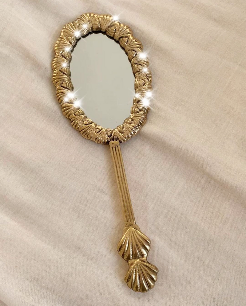 Hand mirror with shells