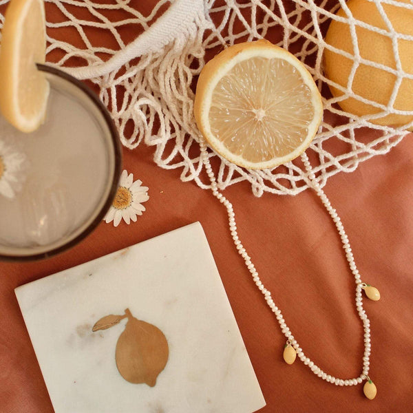 Marble coaster with brass lemon