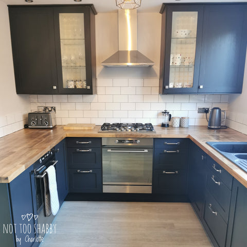 Ash painted kitchen with wood worktops