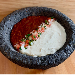 AlbaLisa Spicy Jalapeño Sauce (Red) and Jalapeño Cream Sauce (white) in a Molcajete