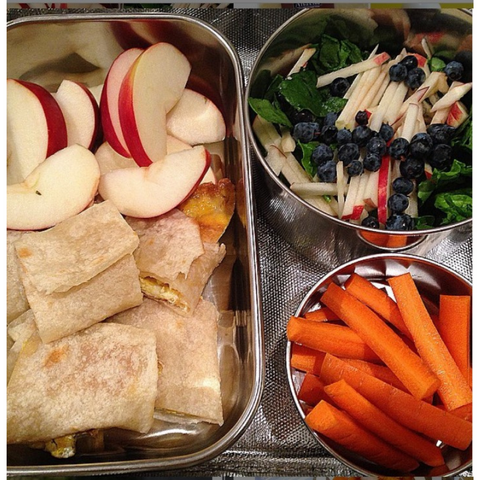 AlbaLisa Breakfast Roll Ups in a lunchbox with cut up apples and a salad.