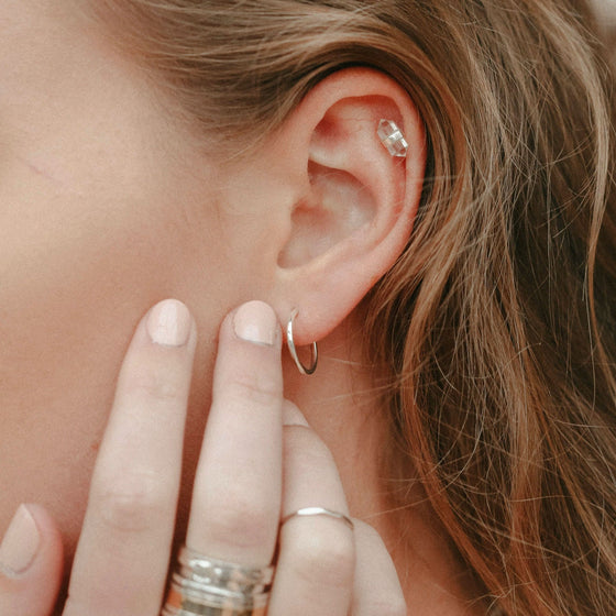 silver-huggie-earring-on-ear