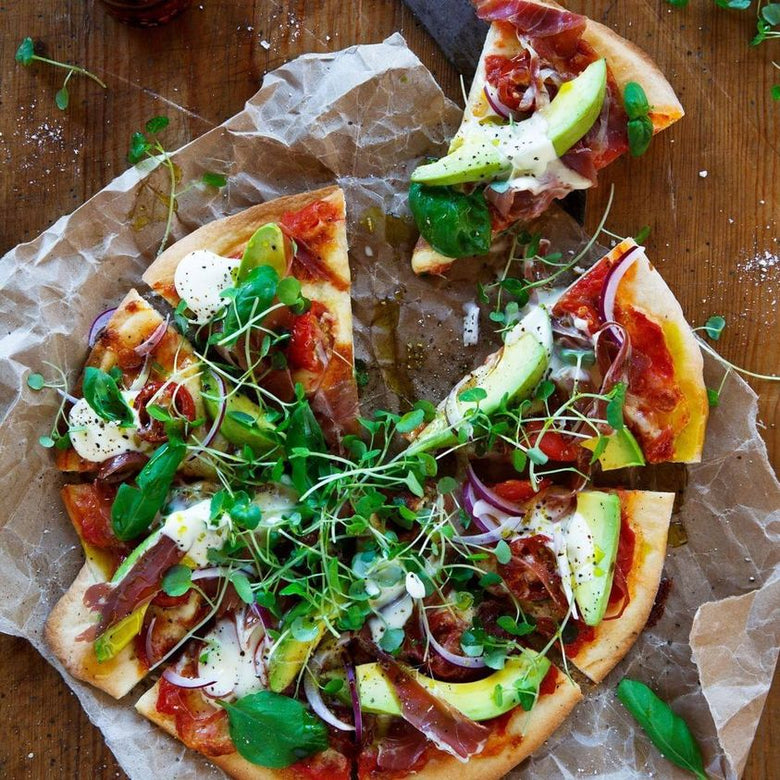 Avocado and prosciutto pizza