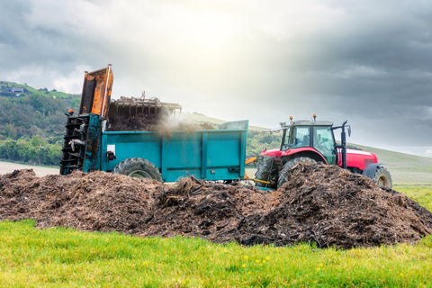 tractor next to manure heap