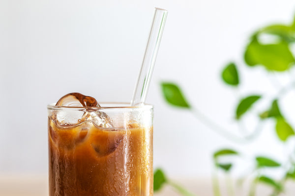 Glass drinking straw in cup