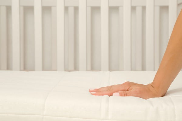 hand on bamboo sheets