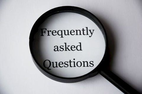 Magnifying glass with Frequently Asked Questions