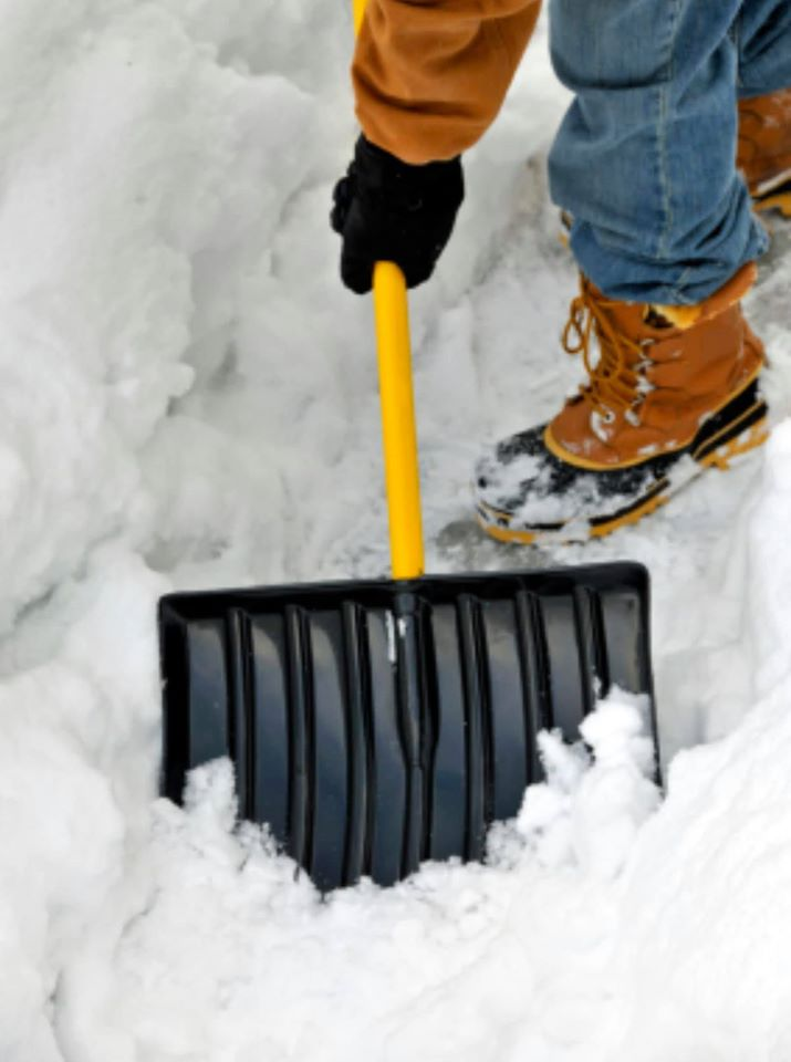 Man shovelling snow, snow removal