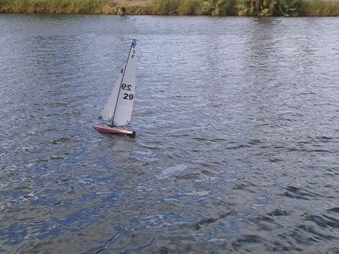 Taking fiberglass RC yacht out to sail.
