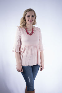 Peplum top with bell sleeves