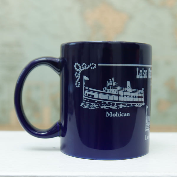 Cobalt blue ceramic coffee mug featuring the Minne, Mohican and Saint