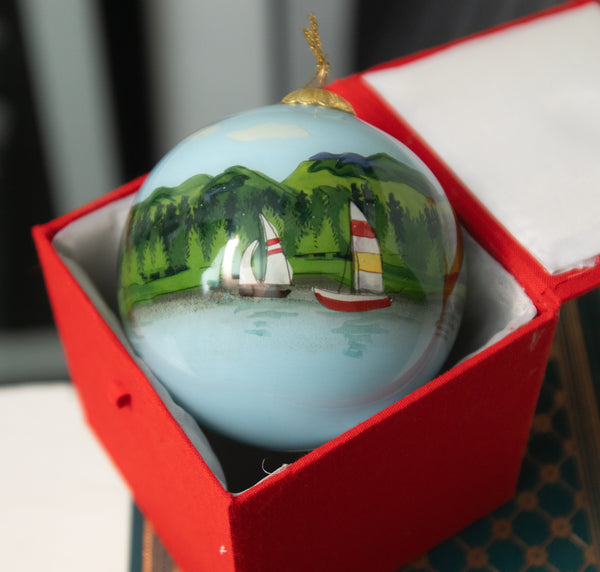 Mohican Painted Glass Globe Ornament in Cloth clad padded box
