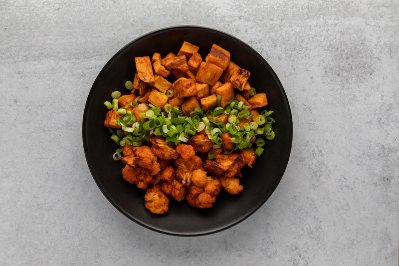 Buffalo Cauliflower with Roasted Sweet Potatoes