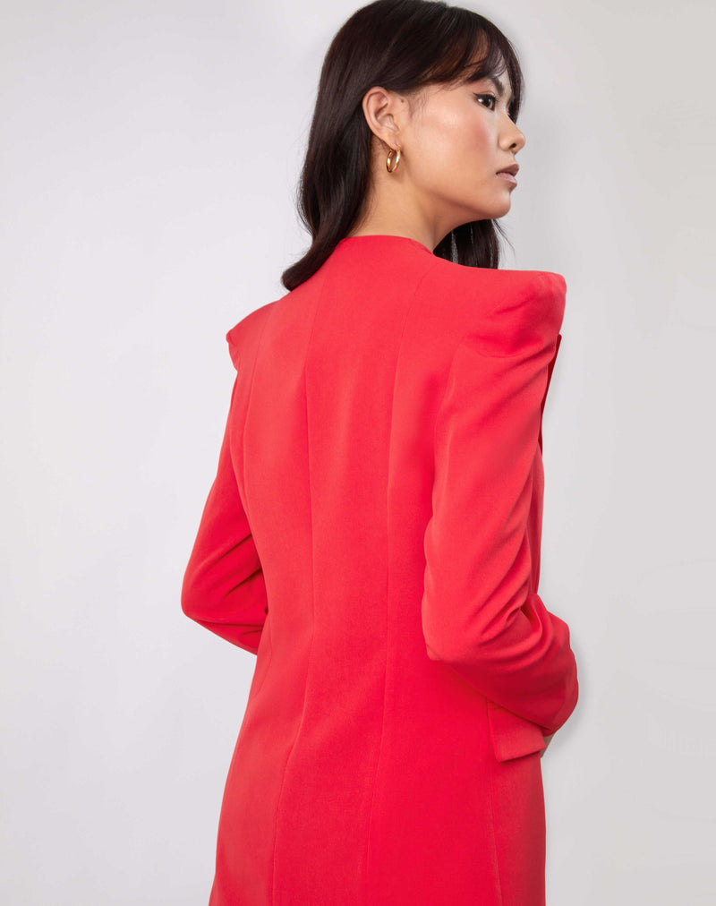 the model looks over her shoulder showing the back of the Quinn Red Double Breasted Blazer