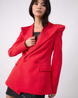 the model hold her hand to her chest while wearing the Quinn Red Double Breasted Blazer buttoned up