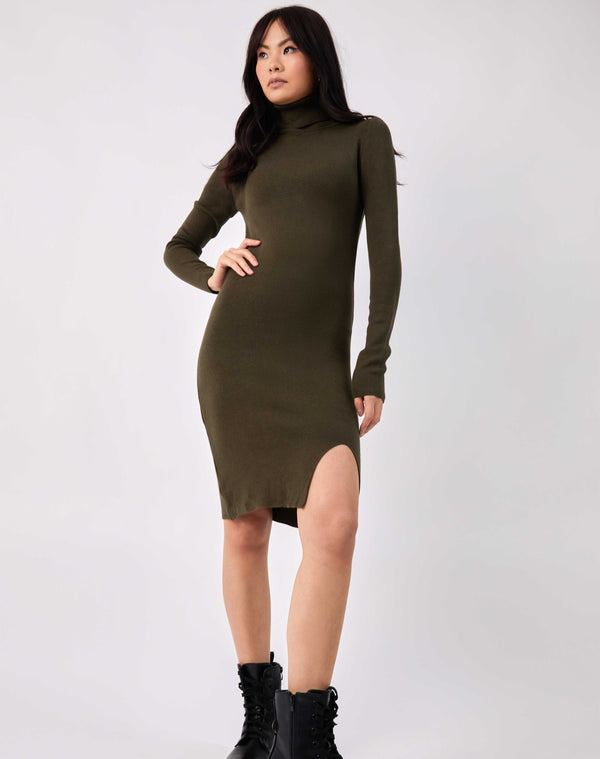 full length image of model with her hands on her hips in the liana olive green roll neck knit midi dress wearing military boots