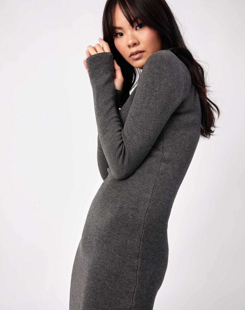 model poses with arms up in front of her face to the side in the liana grey roll neck knit midi dress