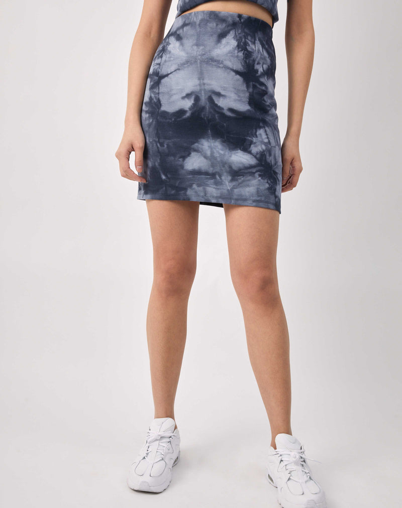 a close up cropped image of Luiza Blue Ribbed Tie Dye Skirt with white trainers