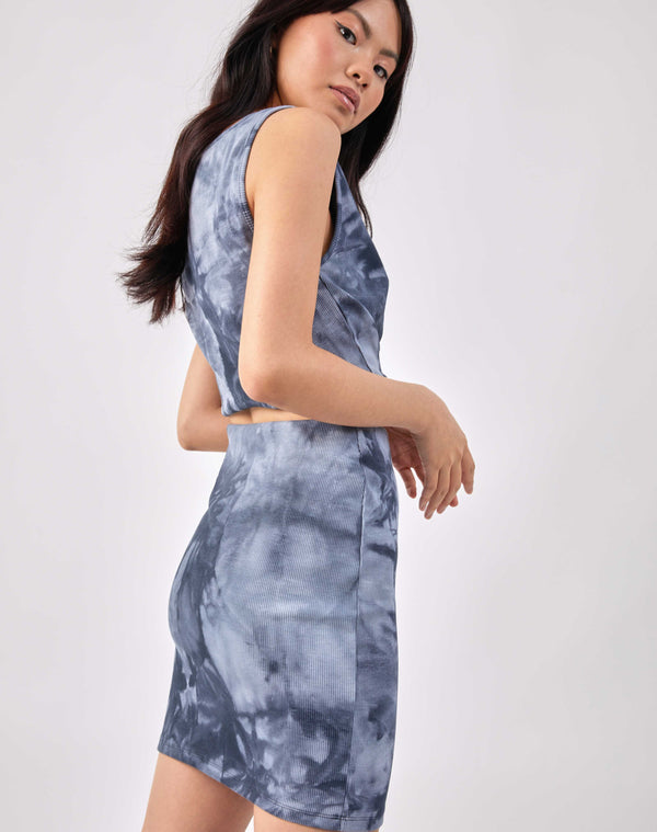 the model wears the angie ribbed blue tie dye top, looking over her shoulder and showing the back along with the matching skirt
