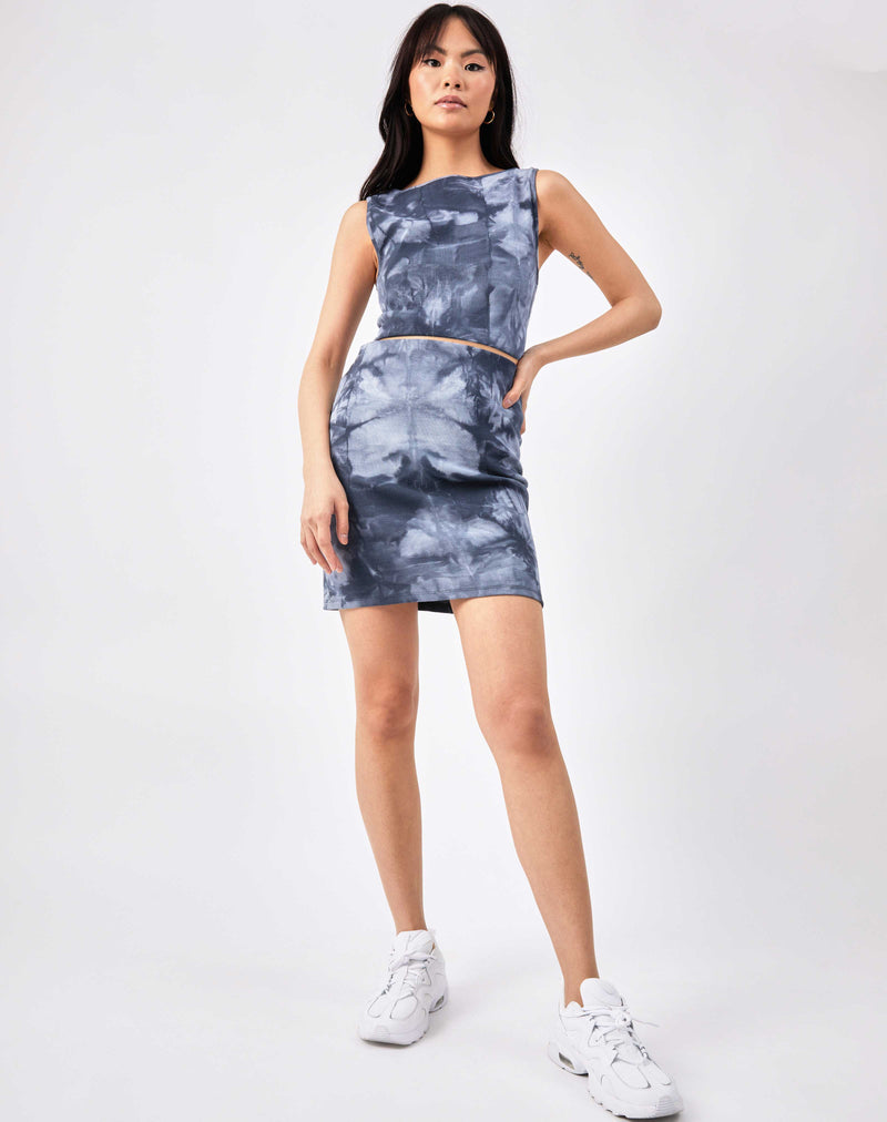 full length image of model wearing the Luiza Blue Ribbed Tie Dye Skirt and matching top with trainers