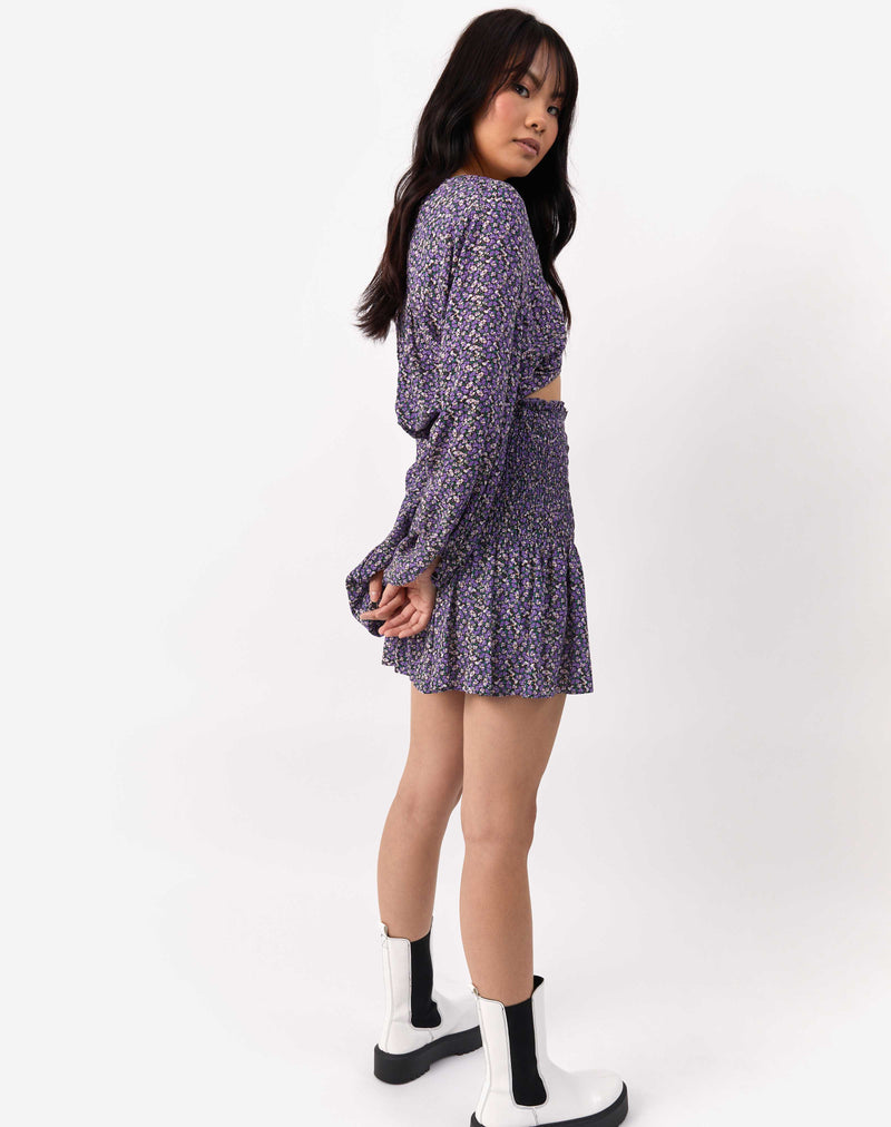 the model is turned to the side wearing the Una Shirred Skirt in Lilac Floral