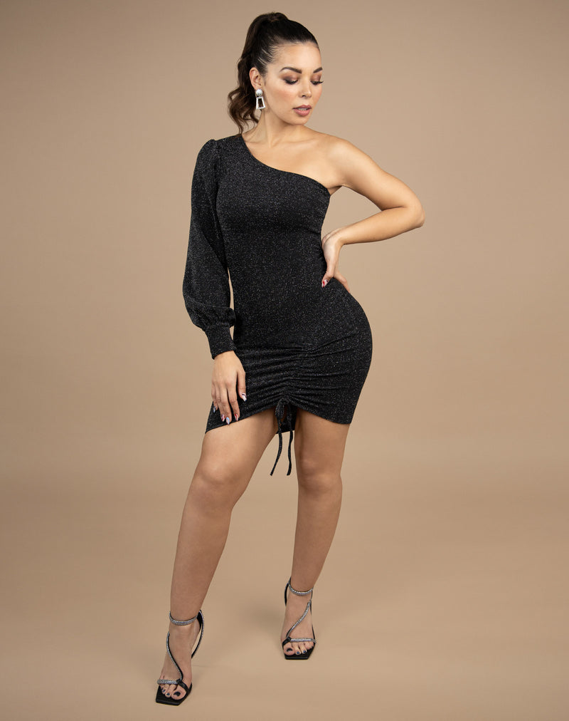 full length image of model with hand on her hip wearing the jessie one shoulder lurex dress with front ruching with black heels