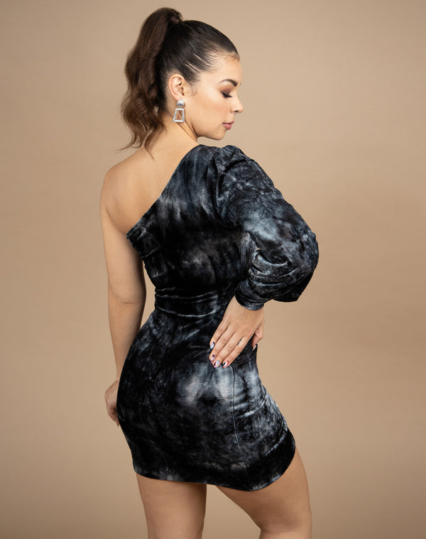 model looks away from camera wearing thhe jessie one shoulder velour dress showing the back of the piece