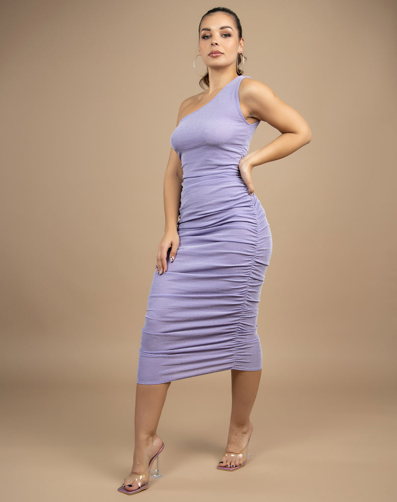 model wears the Raquel Lilac Ruched Midi Dress with her hands on her hips with perspex heels