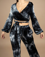 a cropped image of the model wearing the fran tie dye velour wrap top with tie detail and matching trousers