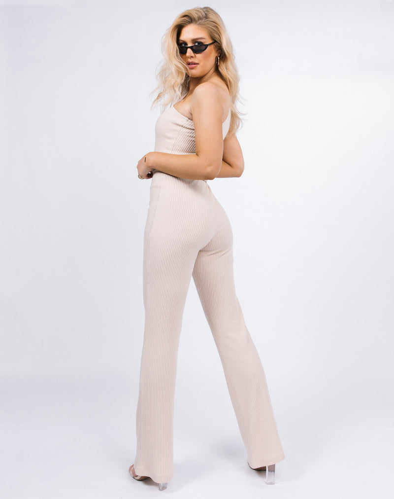 model looks over her shoulder wearing the Laura One Shoulder Jumpsuit in Ribbed Oyster
