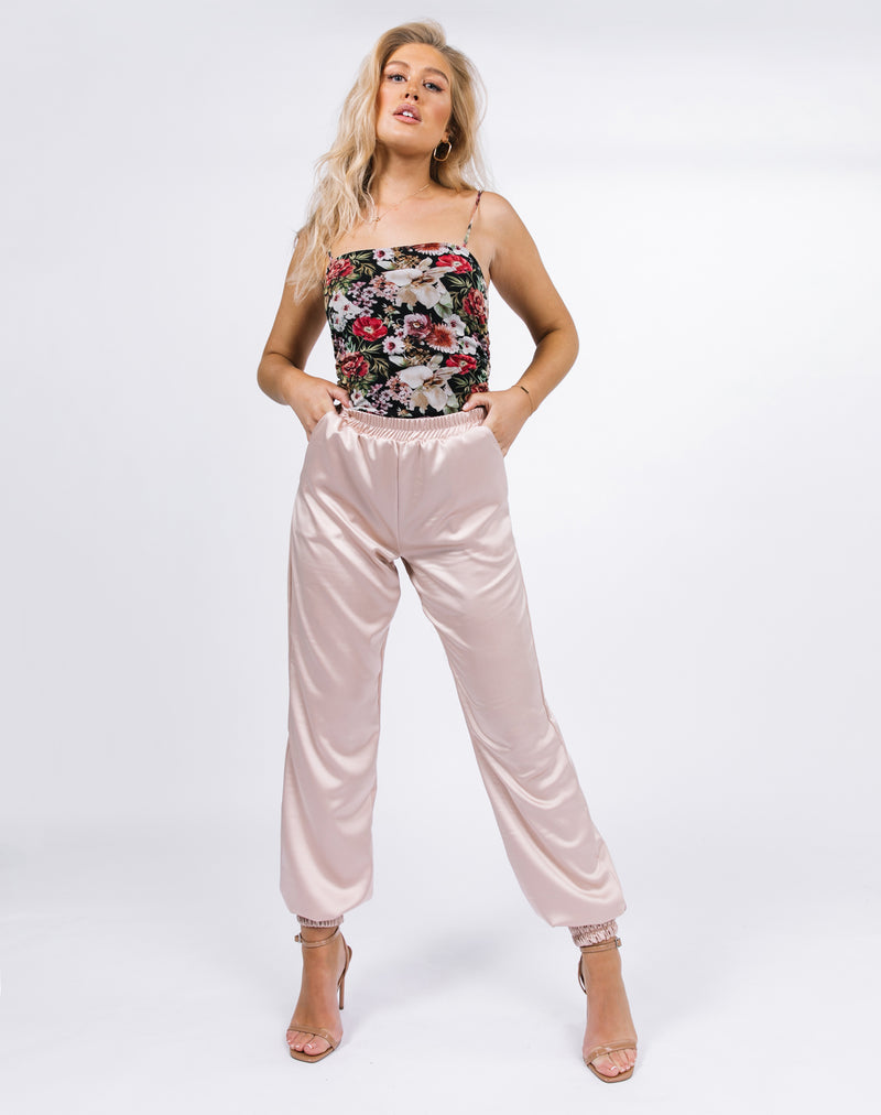 model poses in the kyla champagne satin joggers with mesh floral bodysuit and heels