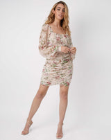 full length image of model wearing the jana gathered floral mini dress in pale pink with nude perspex heels