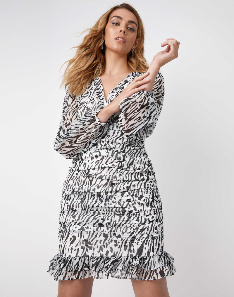 model wears the Ruby Ruched Wrap Dress In Animal Print with her arms in front of her