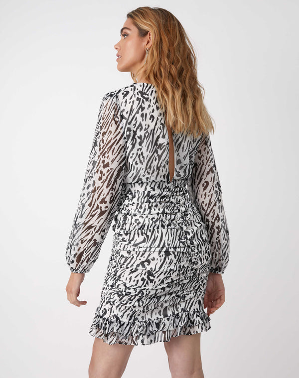 we see the back of the model in the Ruby Ruched Wrap Dress In Animal Print