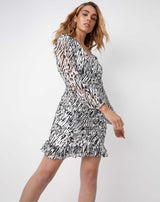 the model is moving in front of the camera wearing the Ruby Ruched Wrap Dress In Animal Print