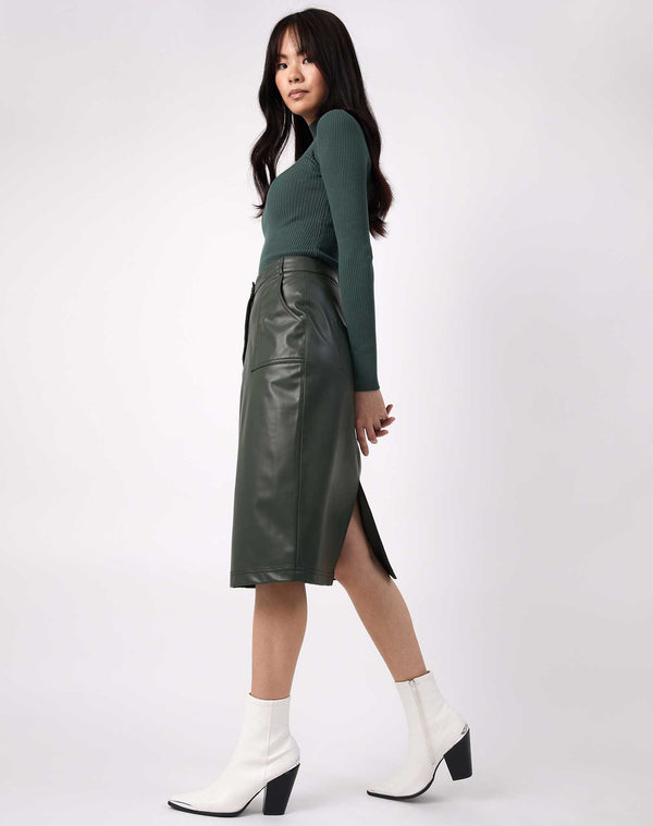model wears Vita Green PU Midi Skirt With Pockets with ribbed knit and white boots