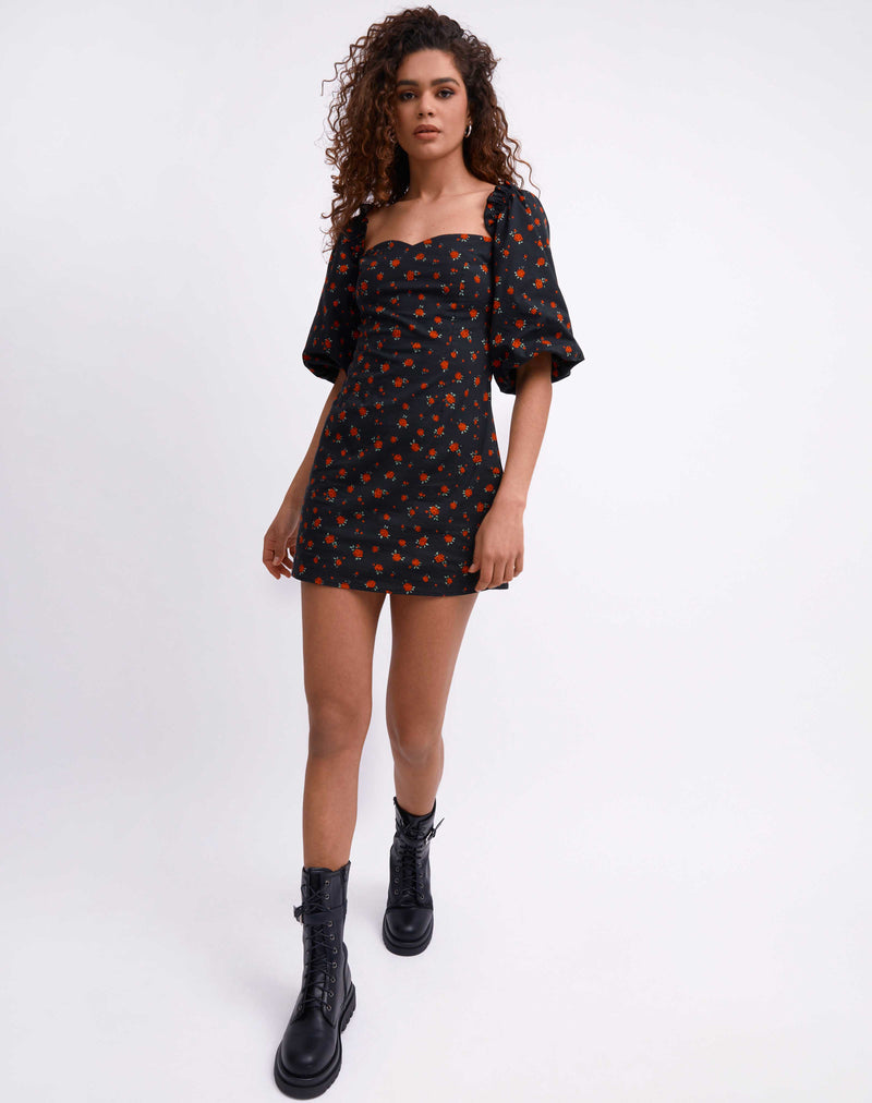 model wears the charlotte rose print puff sleeve mini dress while walking towards the camera in chunky boots