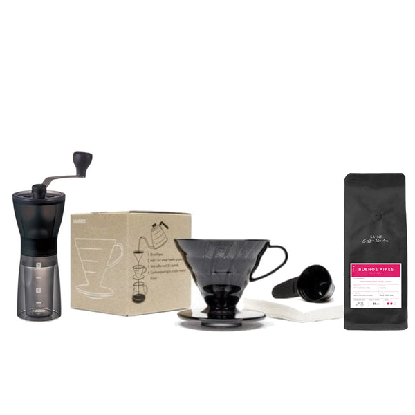 The Home Brew Start Kit | 1x Hario Mini Mill hand grinder | 1x Black Transparent V60 Dripper | 1x Black Coffee Scoop | 40x Filter Papers | 1x 200g House Coffee