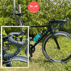 Bowman bicycle wrapped in black tape and with green accents