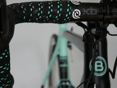 Complete the bartape wrap by securing with the finishing tape