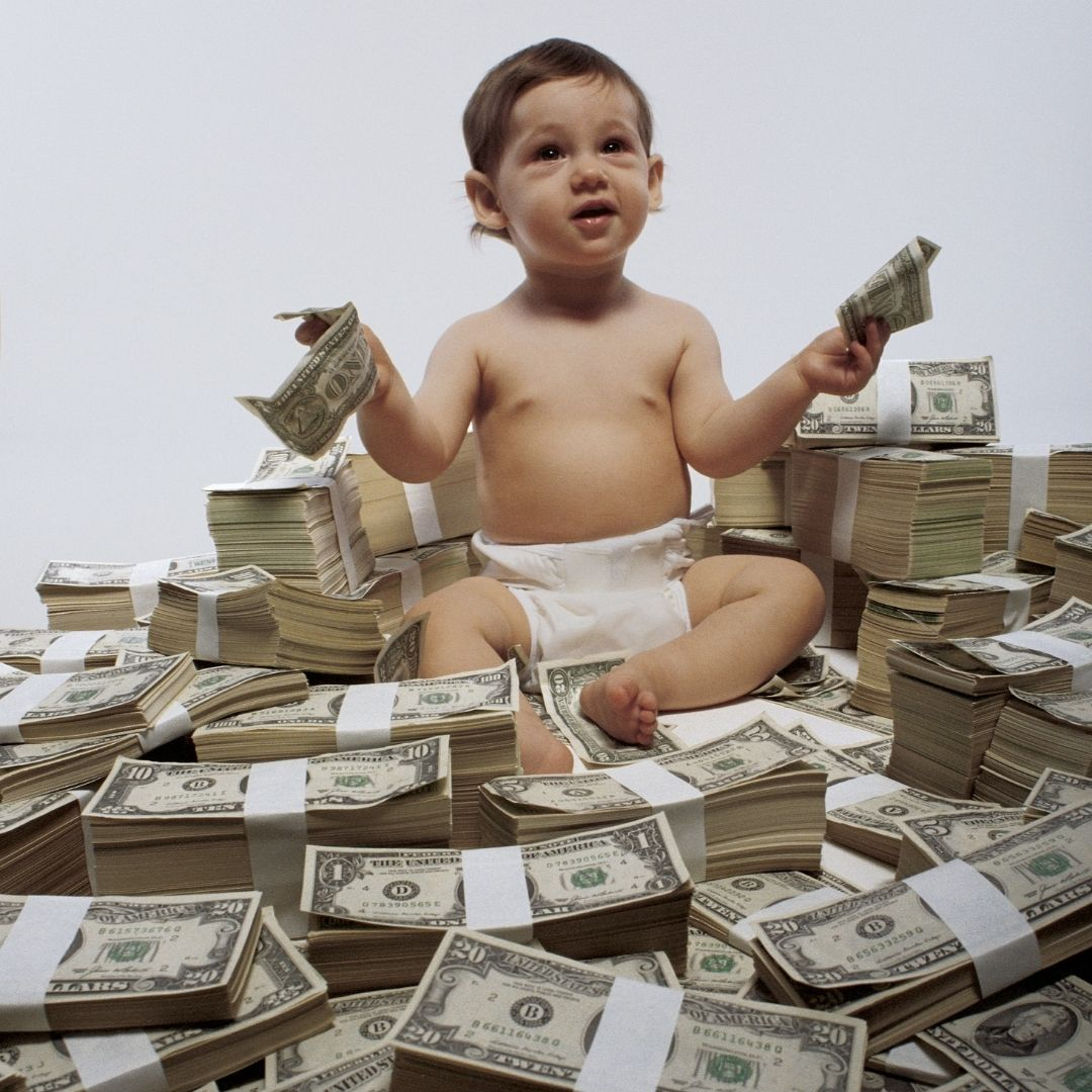 The millionaire baby sitting on a pile of a million bucks!