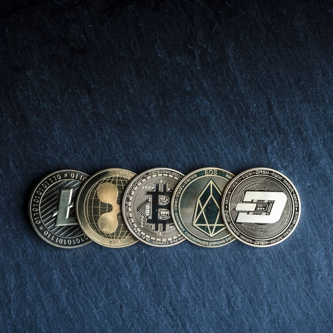 Five Cryptocurrency Coins Laid Out In A Row