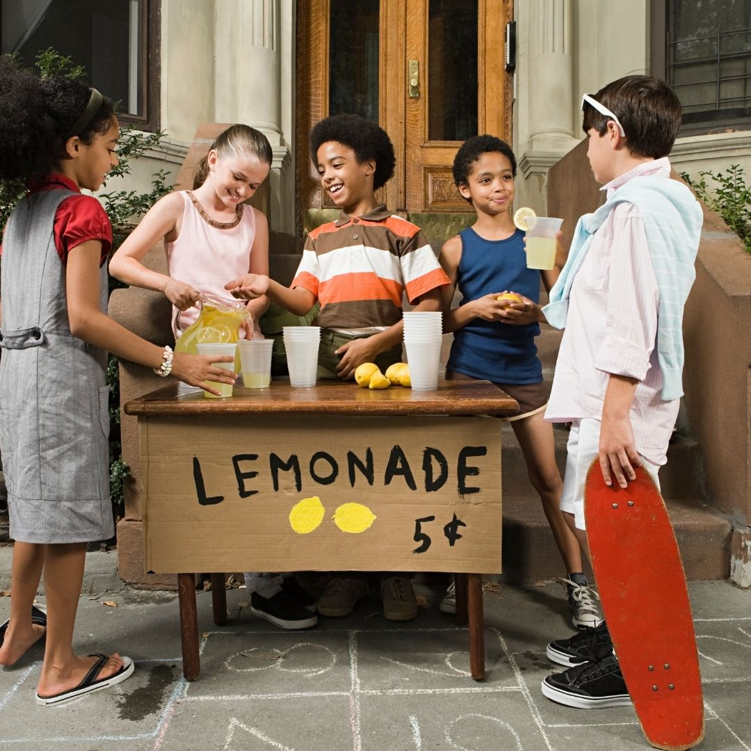 A group of young kids working hard with their new lemonade stand and taking their first steps into the world of entrepreneurship. The journey to entrepreneurship doesn't have to be with both feet. It can be fund and rewarding. Just like a lemonade stand!